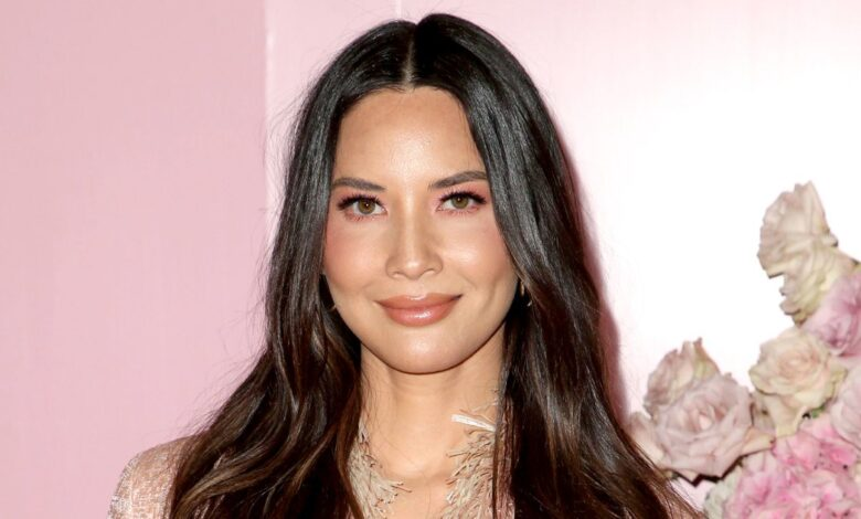 Olivia Munn Recalls Dating a 'Conspiracy Theorist' for Several Years